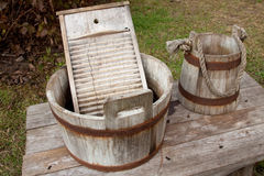 Wash it up 2. A washboard in a washtub with a water pail next to it Stock Images