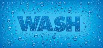 Wash word with water drops on blue background Stock Image