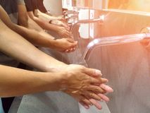 Wash your hand on the sink for cleanliness and hygiene. royalty free stock images