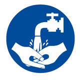 Wash your hands sign. Wash your hands blue sign Royalty Free Stock Images