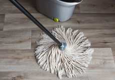 Wash your wooden floors with Stock Image