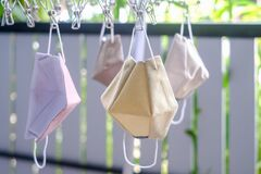 Free Washable Cloth Face Anti-virus Masks Is Hang Dry On Hanging Rack , Reuse And Health Protection From Coronavirus. Royalty Free Stock Photos - 181465328