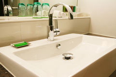 Washbasin. Fresh and clean washbasin and chrome tap Stock Photography