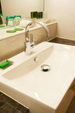 Washbasin. Fresh and clean washbasin and chrome tap Royalty Free Stock Photos