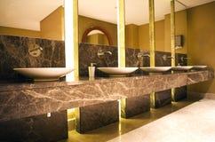 Washbasin. Elegance marbel washbasin and interior hotel bathroom Stock Photography