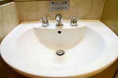 Washbasin. Detail of Washbasin, with one faucet and two switch for hot and cold water Stock Images