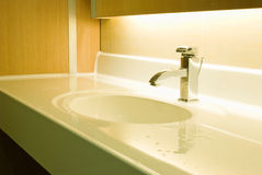 Washbasin and chrome tap Royalty Free Stock Image