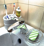 Washbasin. Close up of the washbasin. Water running from the tap Royalty Free Stock Photography