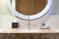 Washbasin with decoration in bathroom Stock Photo