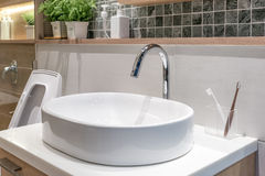 Washbasin with decoration in bathroom Royalty Free Stock Photo
