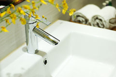 Washbasin and faucet at home. Stock Images