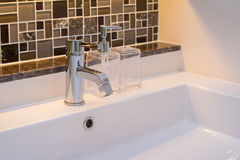 Washbasin with faucet and liquid soap bottle Royalty Free Stock Images