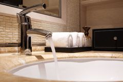Washbasin and faucet in a toilet stock photo