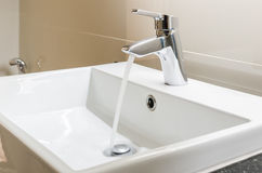 Washbasin and faucet with water drop Royalty Free Stock Photography