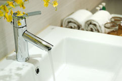 Washbasin and faucet with water drop at home. Royalty Free Stock Image