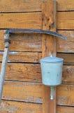 Washbasin and scythe Stock Image