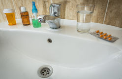 Washbasin with several bottles of medicine Stock Photography