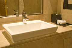 Washbasin and tap. Fresh and clean washbasin and stainless steel tap Stock Photo