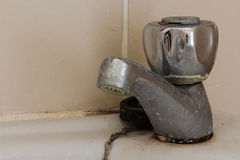 Washbasin Tap. Dirty tap of washbasin in unclean bathroom Stock Photography