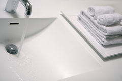 Washbasin and towels Stock Photos