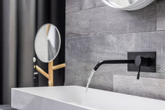 Washbasin with wall mounted tap Stock Photos