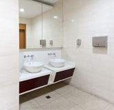 Washbasins, Taps And Mirror In Public Toilet Stock Photo