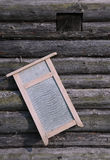 Washboard on Old Log House Wall Royalty Free Stock Image