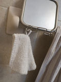 Washcloth hanging from mirror Stock Photography