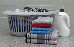 Washday. Dirty and clean laundry and detergent on a table in the washhouse Royalty Free Stock Photos