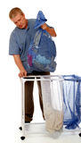 Washday. A man removes a bag of dirty clothes from the laundry sorter/hamper for washing.  isolated on white Stock Photos
