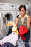 Washday. A young woman has wash-day Royalty Free Stock Images