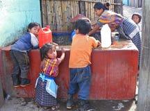 Washday in Guatemala. Guatemalan family at public washbasins Royalty Free Stock Photos
