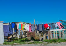 Washday in shanty town. Washing blows in the breeze and dries in the sun. A squatter camp near Cape Town, South Africa Stock Photos