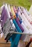 Washday in spring. Clothesline  with  color clothes on the dryer Royalty Free Stock Photos