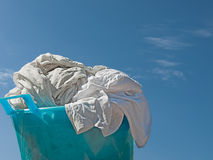 Washday - washing in bowl against sky. White washing in old stye plastic bowl Royalty Free Stock Image