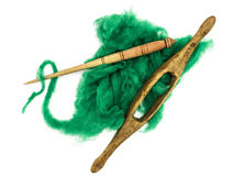 Washed Angora wool for felting or knitting. The distaff and spindle closeup on a white background. Stock Images