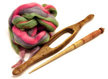 Washed Angora wool for felting or knitting. The distaff and spindle closeup on a white background. Stock Photo