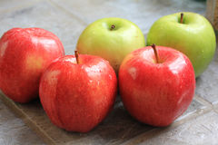 Washed Apples. Red and green apples that have been washed and are sitting on a slate file kitchen counter Stock Images