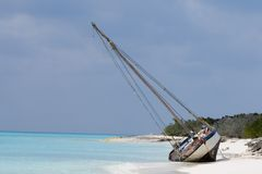 Washed Ashore. Haitian boat washes ashore on a remote island in the Bahamas Stock Photography