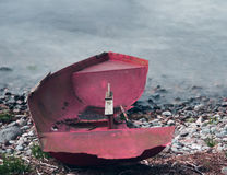 Washed ashore. Small dinghy washed ashore on loch rannoch royalty free stock photography