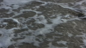 ?' Washed Away on the Beach. Question mark written in the sand, water rushes over and washes it away. Shot on HDV 1080 stock video footage