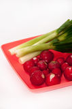 Washed and cleaned radishes on the plastic plate Stock Photography