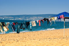 Washed clothes. Drying on the beach Royalty Free Stock Photo