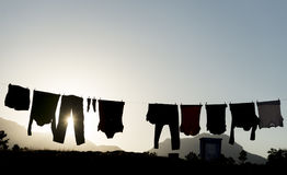 Washed clothes and clothes hanged. Silhouette ;Washed clothes and clothes hanged Royalty Free Stock Image