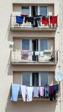 Washed clothes drying on the balcony of the house Royalty Free Stock Photos