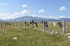 The washed clothes drying on the line and the Durmitor mountain in the distance Royalty Free Stock Photos