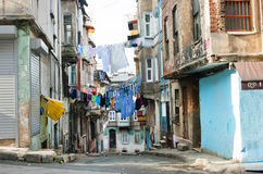 Washed clothes drying on a rope between historical houses of a street Royalty Free Stock Images
