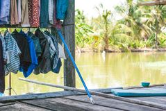 Washed cloths is hanging on wire for drying on wooden floor of T royalty free stock photos