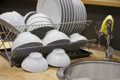 Washed Dish. Clean, washed dish drying. Shallow d o f Royalty Free Stock Photos