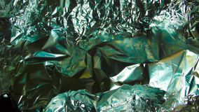 Fading Aluminium Foil with Green and Orange Colors Royalty Free Stock Photography